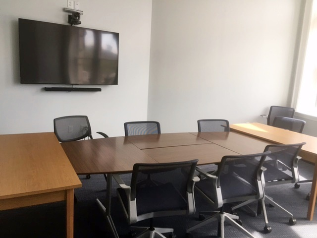 View of the Graduate School conference room in Car Barn, Room 101 showing digital projection screen